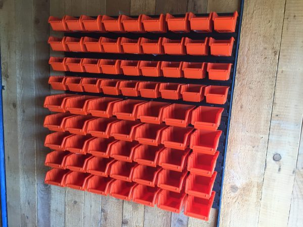 36 small and 35 medium Pegboard Bins being hung on plastic pegboard. This bolt and nut storage solution is ideal for a garage or workshop.