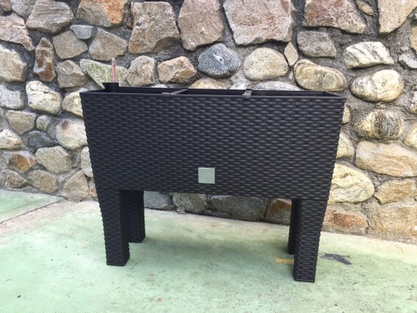 Rattan Style Raised Rectangular Planter is an attractive combination of glamour and functionality. The set includes a watering system and four legs.
