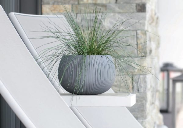 Dress up your indoor or outdoor living space with a fashionable spherical shape of this Faux Concrete Planter. It includes a specially developed insert pot either.